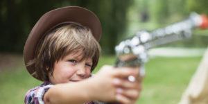 boy with toy gun