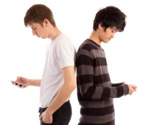 teen boys with smartphones